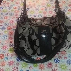 Authentic Coach hobo bag with crossbody strap.